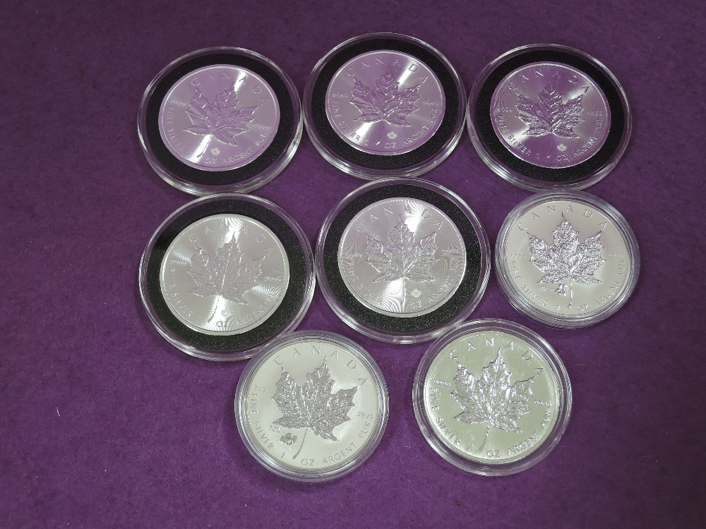 Lot 720 - A collection of 8 silver 1oz Canada Maple leaf 5 dollar coins 6 x 2015, 1996, 2016, some with