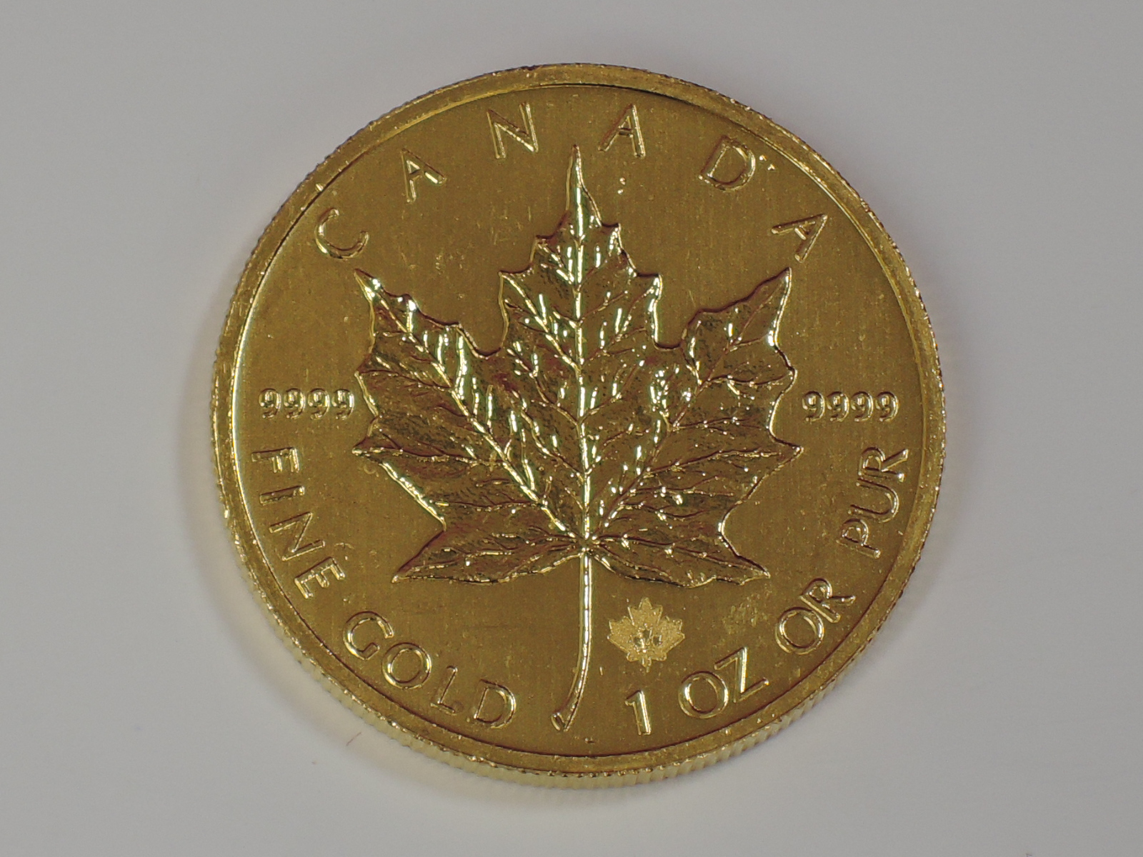 Lot 648 - A gold 1oz 2014 Canada 50 dollar Maple leaf coin, in plastic case
