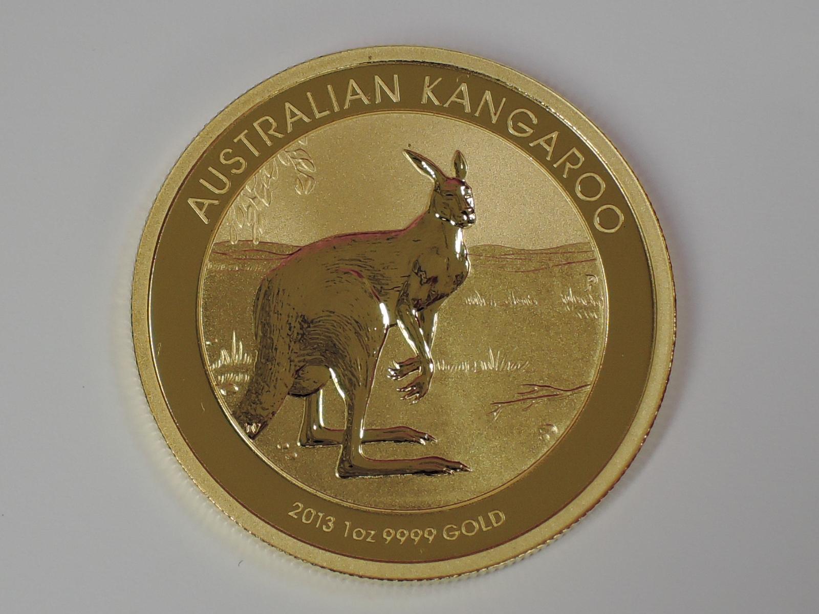 Lot 606 - A gold 1oz 2013 100 dollar Australian Kangaroo coin, in plastic case
