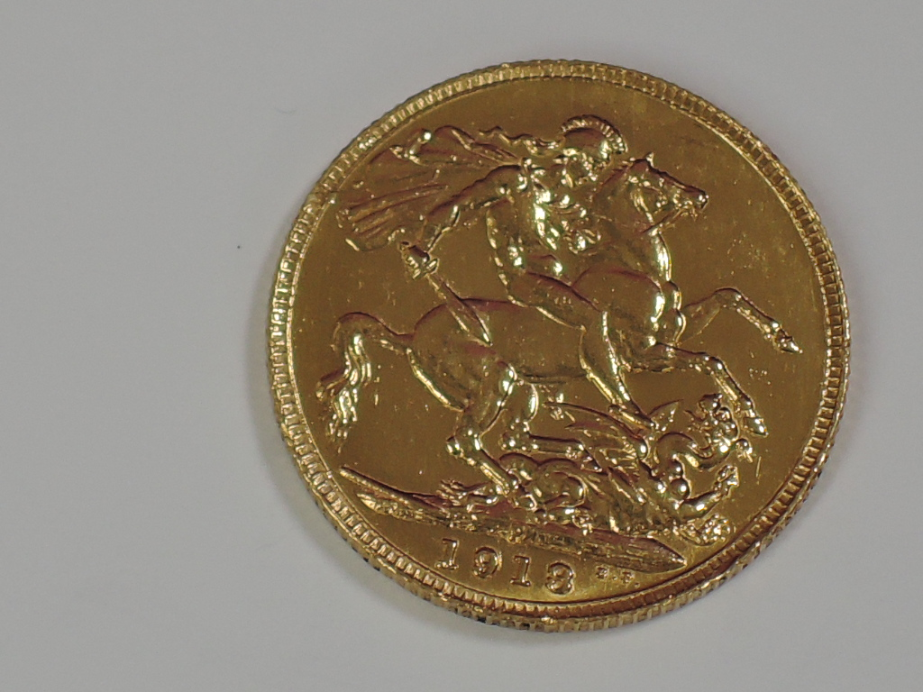 Lot 658 - A gold 1918 Great Britain George V Sovereign, in plastic case, Perth Mint