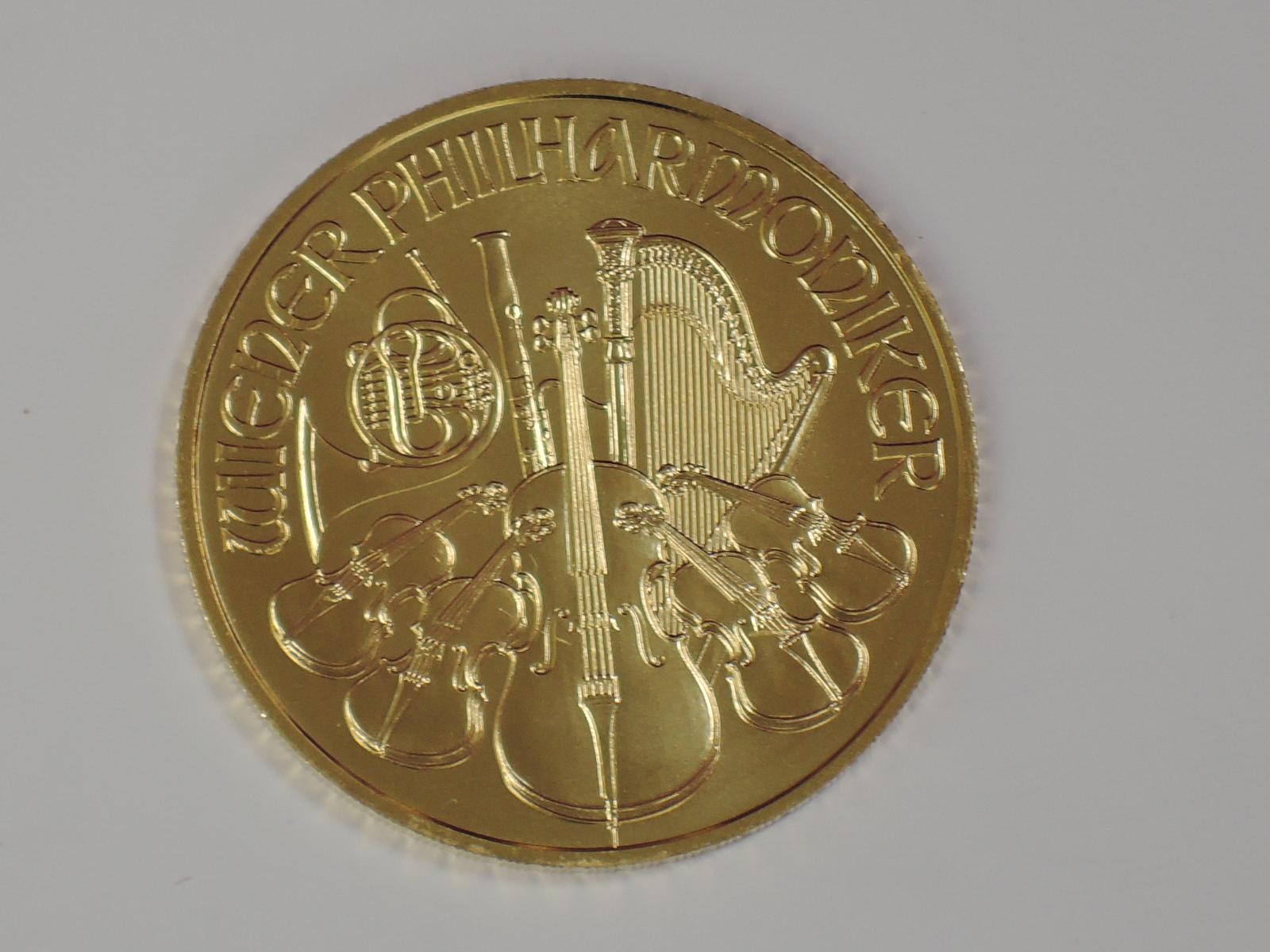 Lot 649 - A gold 1oz 2017 Austria 100 Euro Winer Philharmoniker coin, in plastic case