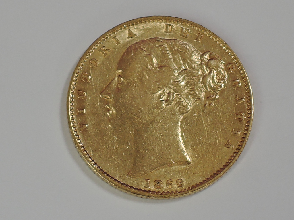 Lot 652 - A gold 1869 Great Britain Victoria, young head, shield back Sovereign with die number 45 below