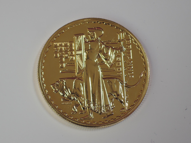 Lot 635 - A gold 1oz 2001 Great Britain Britannia 100 pound coin, in plastic case