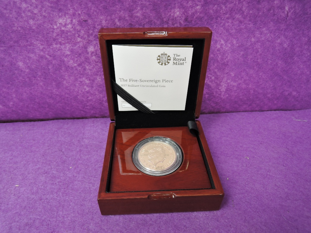 Lot 702 - A gold 2017 United Kingdom Elizabeth II brilliant uncirculated five Souvereign piece coin, in a case