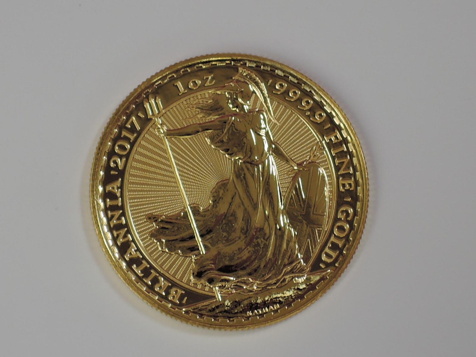 Lot 646 - A gold 1oz 2017 Great Britain Britannia 100 pound coin, in plastic case