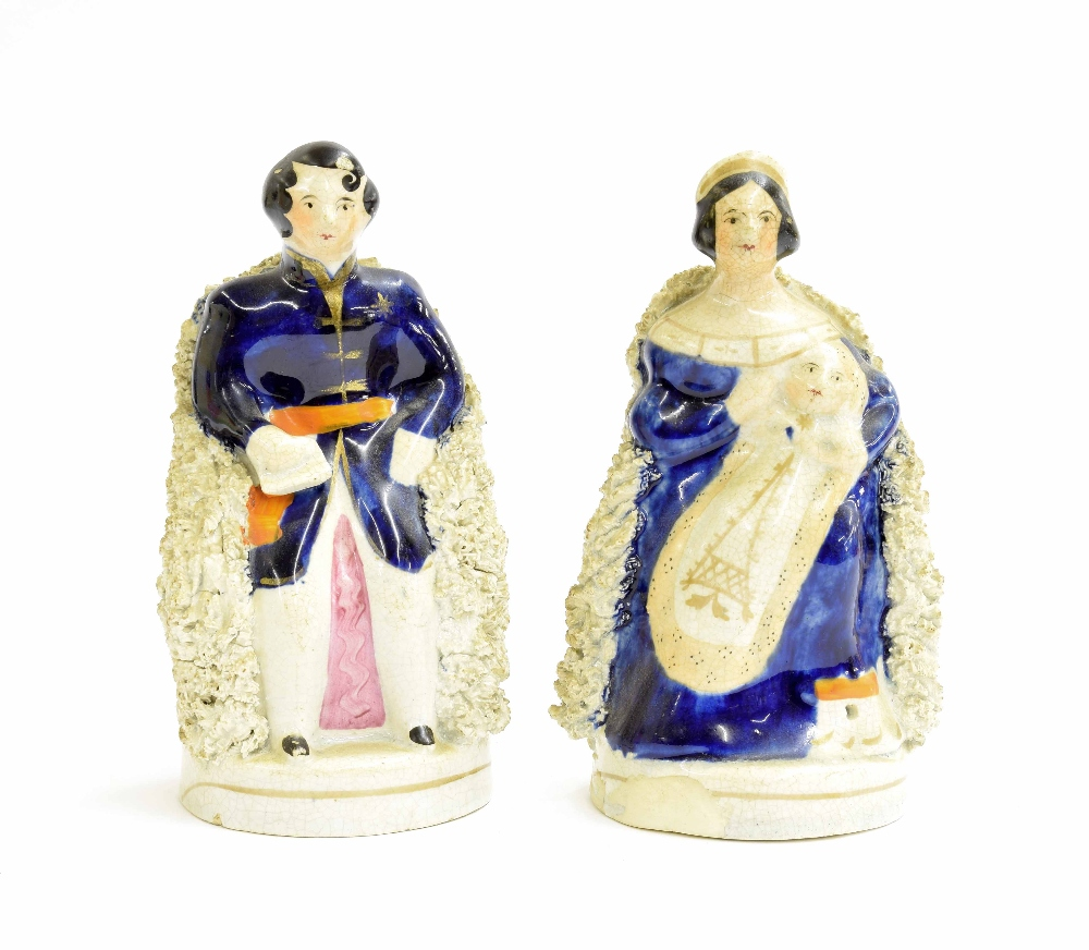 "Lot 52 - Staffordshire porcelain figures modelled as Victoria and Albert, 5.5"" high approx (2)"