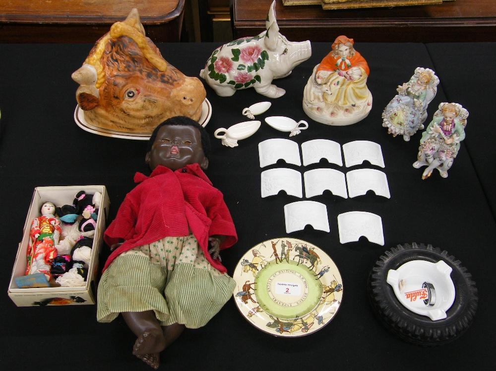 "Lot 2 - Rosebud black baby doll, 17"" long; set of bisque lithophane landscape bowed small plaques,"