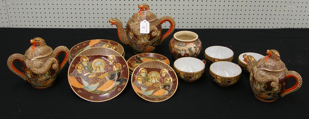 Lot 8 - Japanese Satsuma earthenware part tea service decorated with figures and gilt highlights