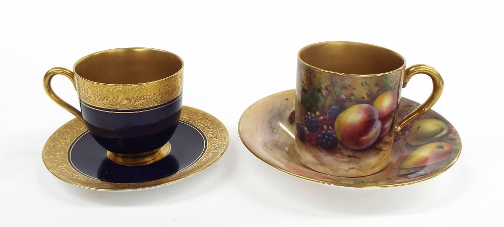 Lot 82 - Royal Worcester porcelain cabinet cup and saucer painted with fruits and gilded highlights, signed