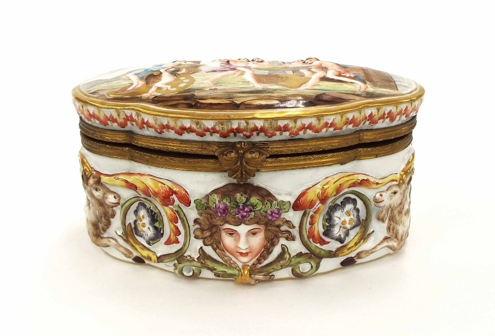 Lot 57 - Naples porcelain serpentine casket, the hinged cover and sides with relief moulded scenes of