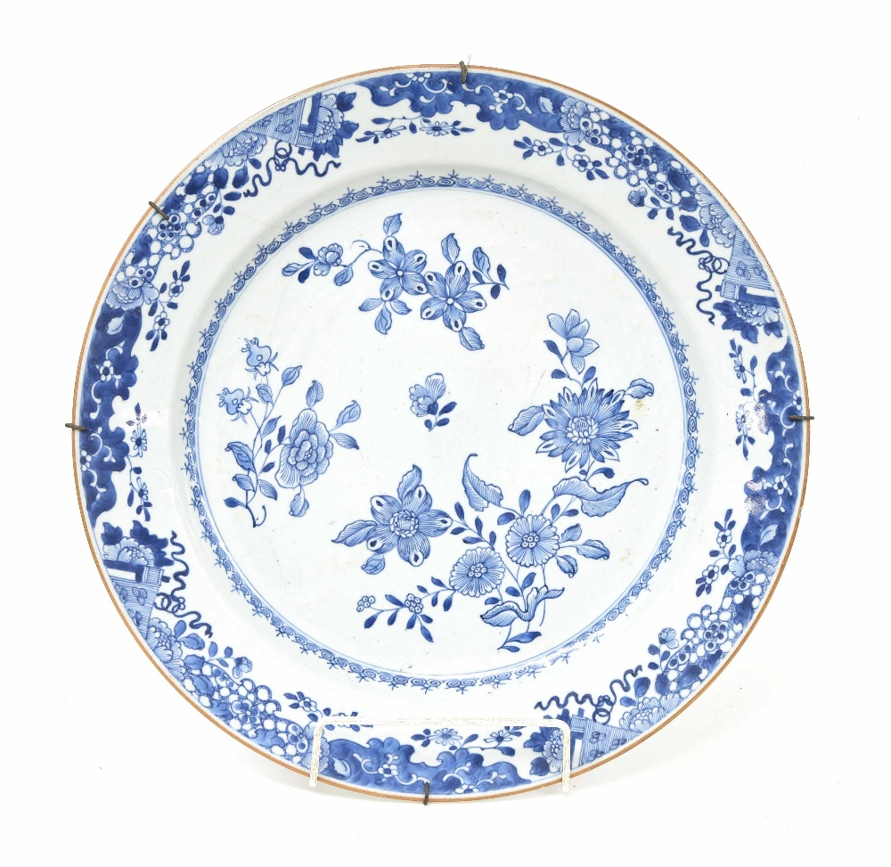 Lot 66 - Chinese blue and white porcelain charger, with flowers to centre within a floral border, 18th