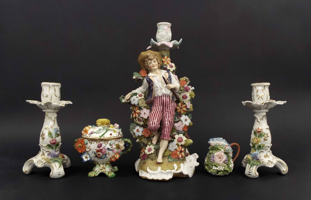 "Lot 63 - Pair of Dresden porcelain floral encrusted candlesticks, 6.75"" high; Continental porcelain figural"