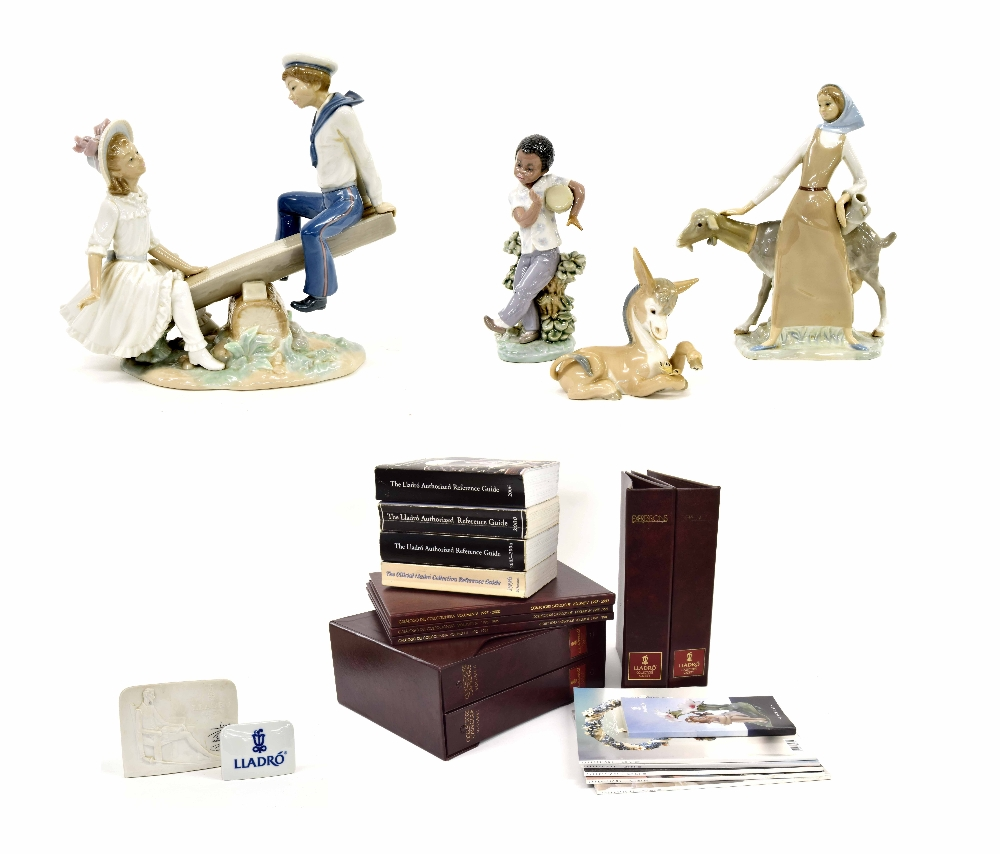 """Lot 58 - Lladró - 'Seesaw', no. 1255 porcelain figural group, 10"""" high, 10"""" wide, together with; 'Girl With"""