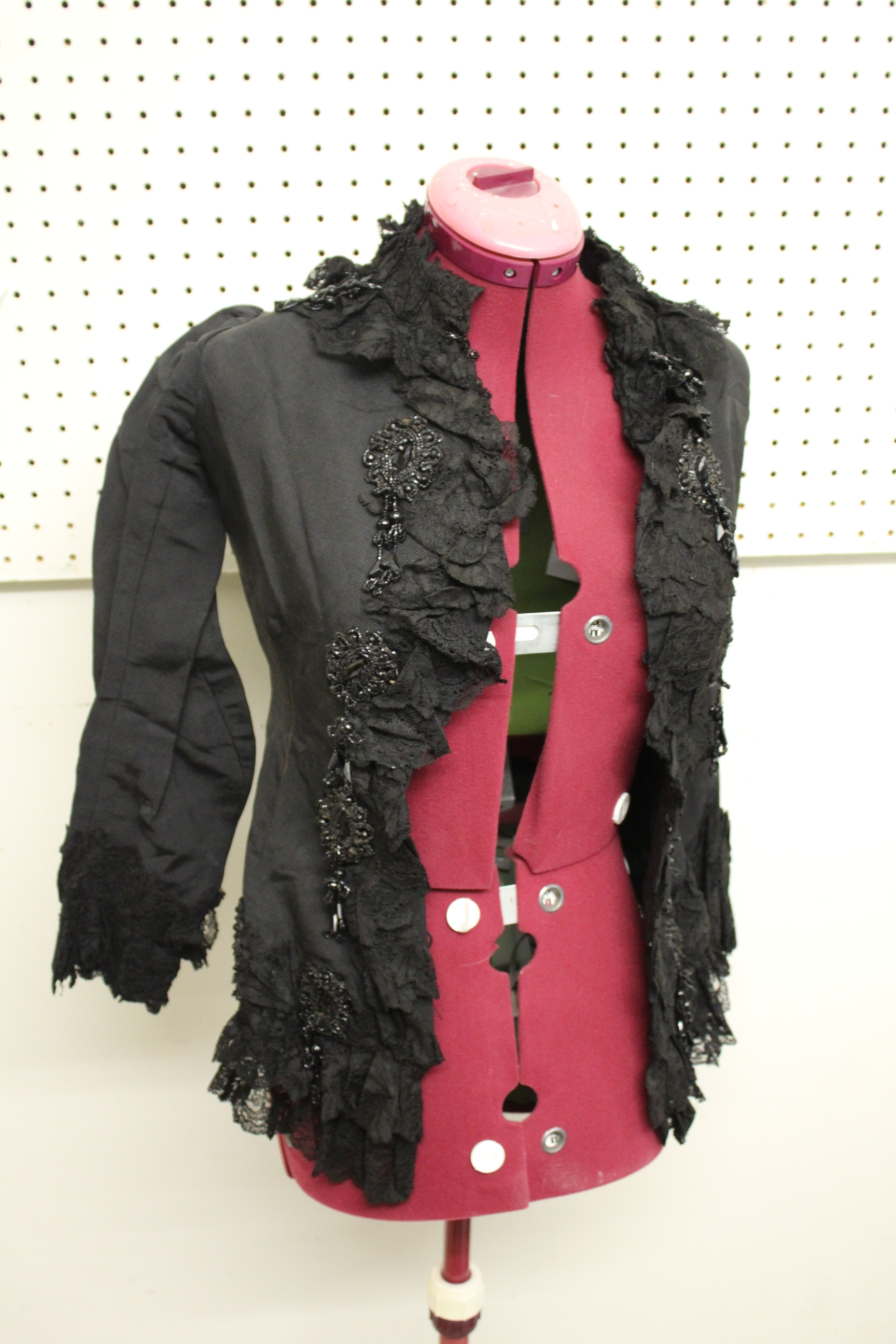 19THC JACKET a black grosgrain jacket embellished with lace and bead embroidered motifs, by Cole