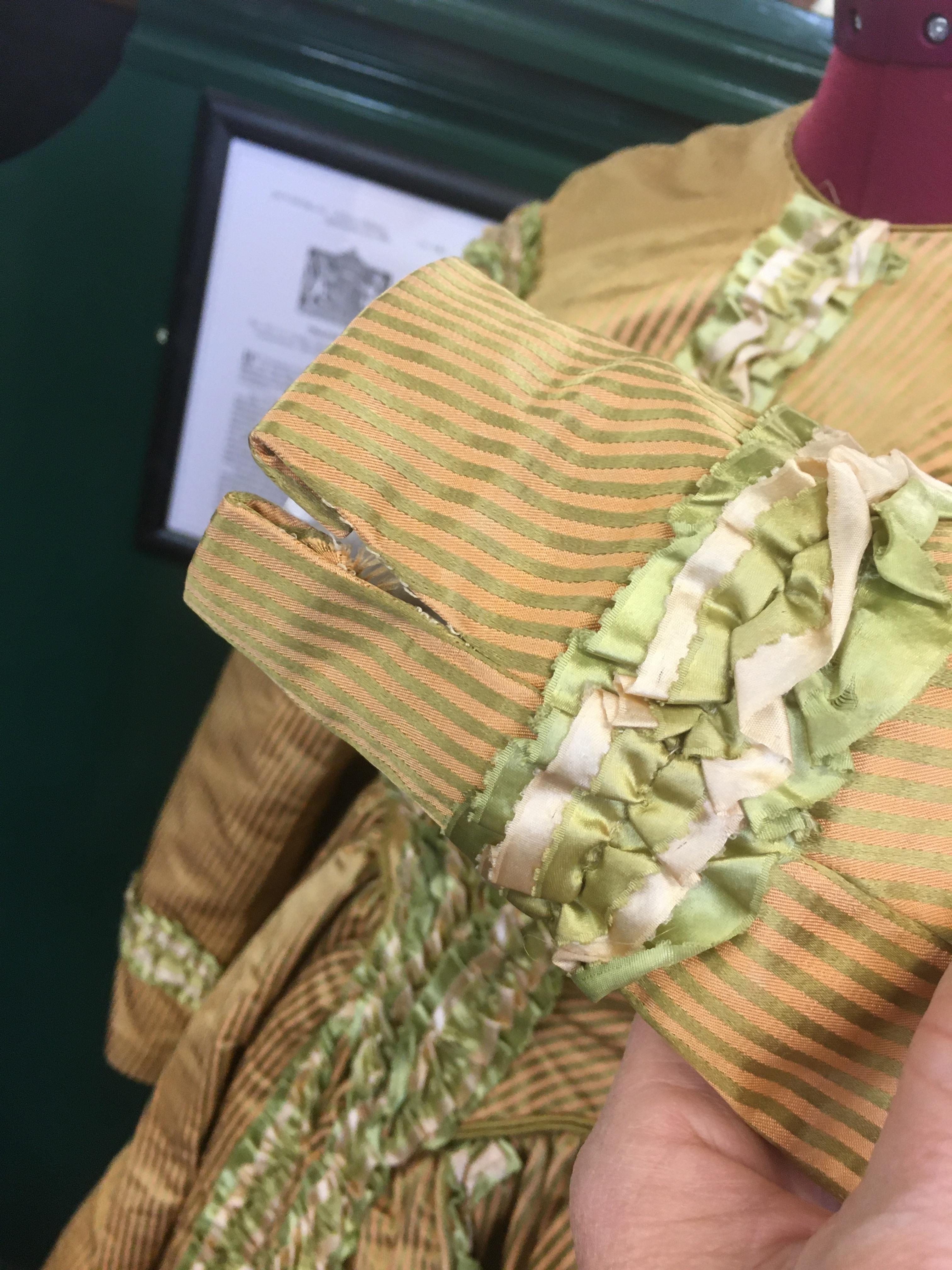 19THC SILK LADIES DRESS a mid 19thc apricot and olive green striped silk dress, decorated with - Image 9 of 9