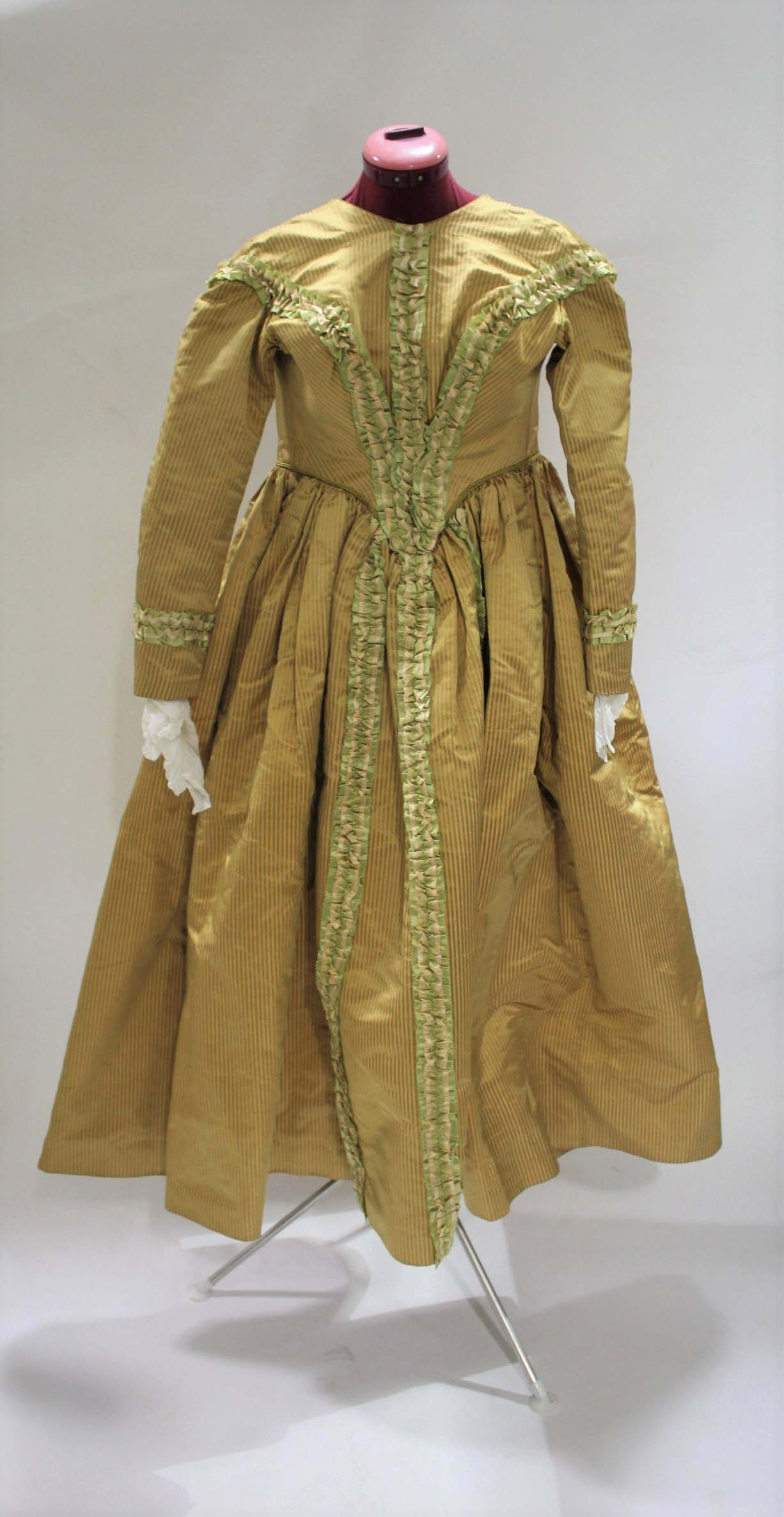 19THC SILK LADIES DRESS a mid 19thc apricot and olive green striped silk dress, decorated with