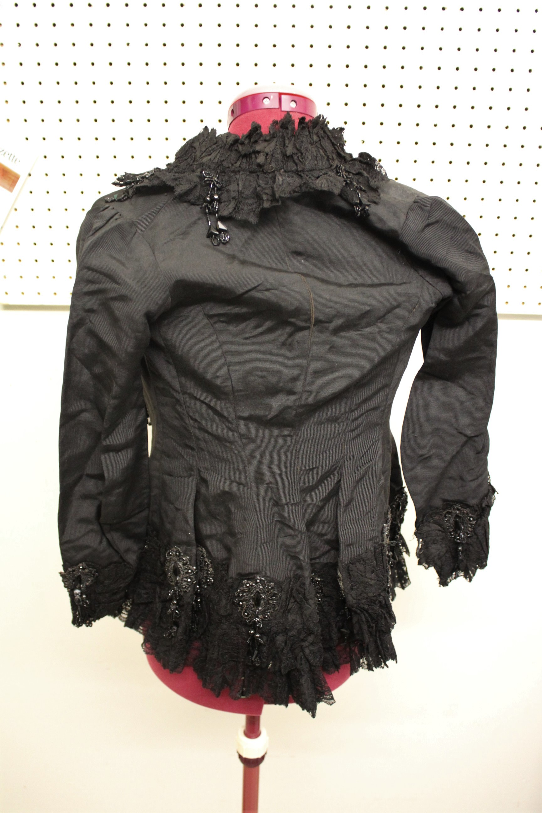19THC JACKET a black grosgrain jacket embellished with lace and bead embroidered motifs, by Cole - Image 4 of 5