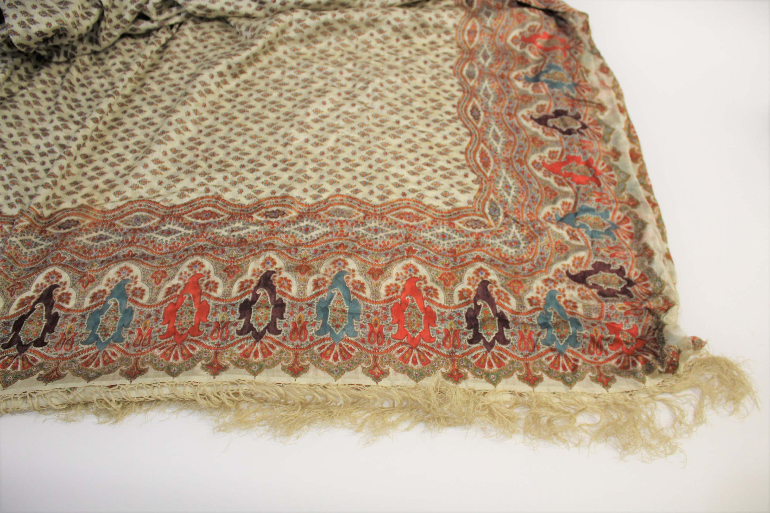 19THC PAISLEY SHAWL a mid 19thc paisley wool cashmere shawl (264cms by 126cms), and also with a fine