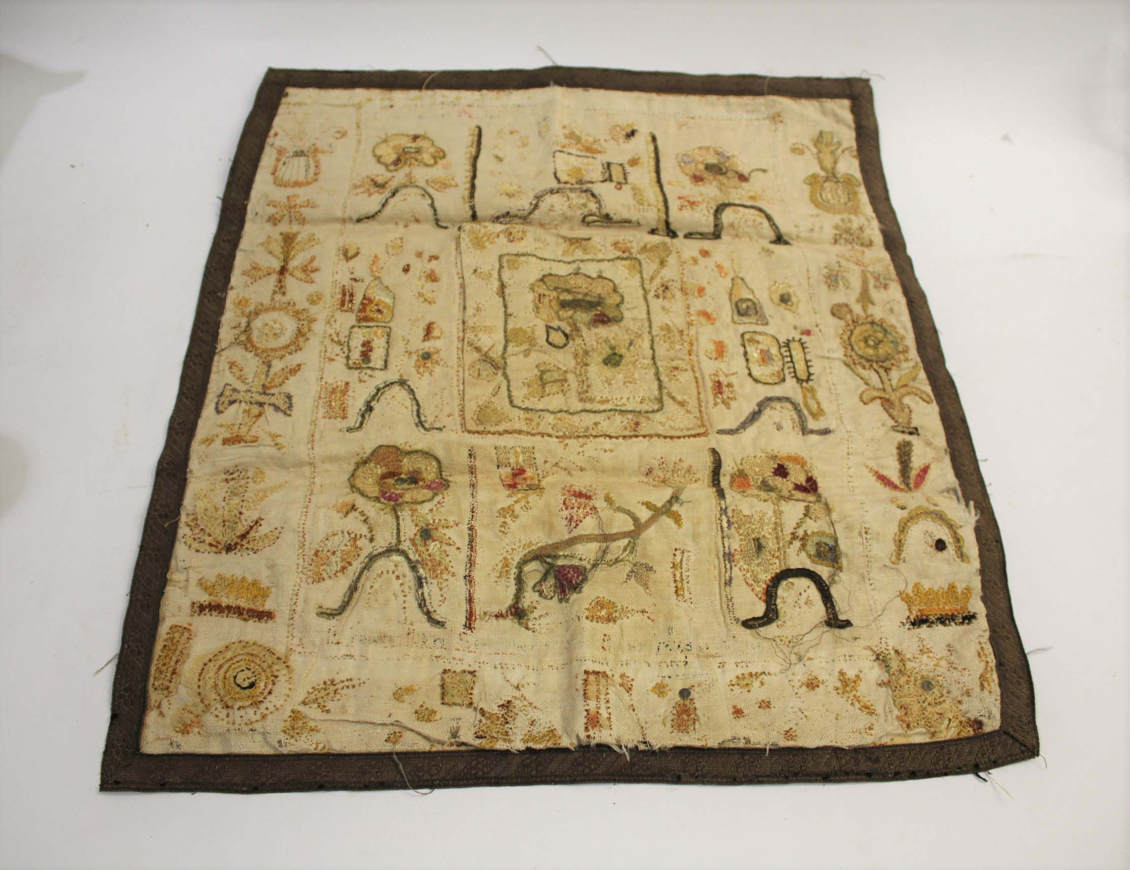 RARE 17THC SPOT SAMPLER a spot sampler onto linen with various flowers depicted, including a later
