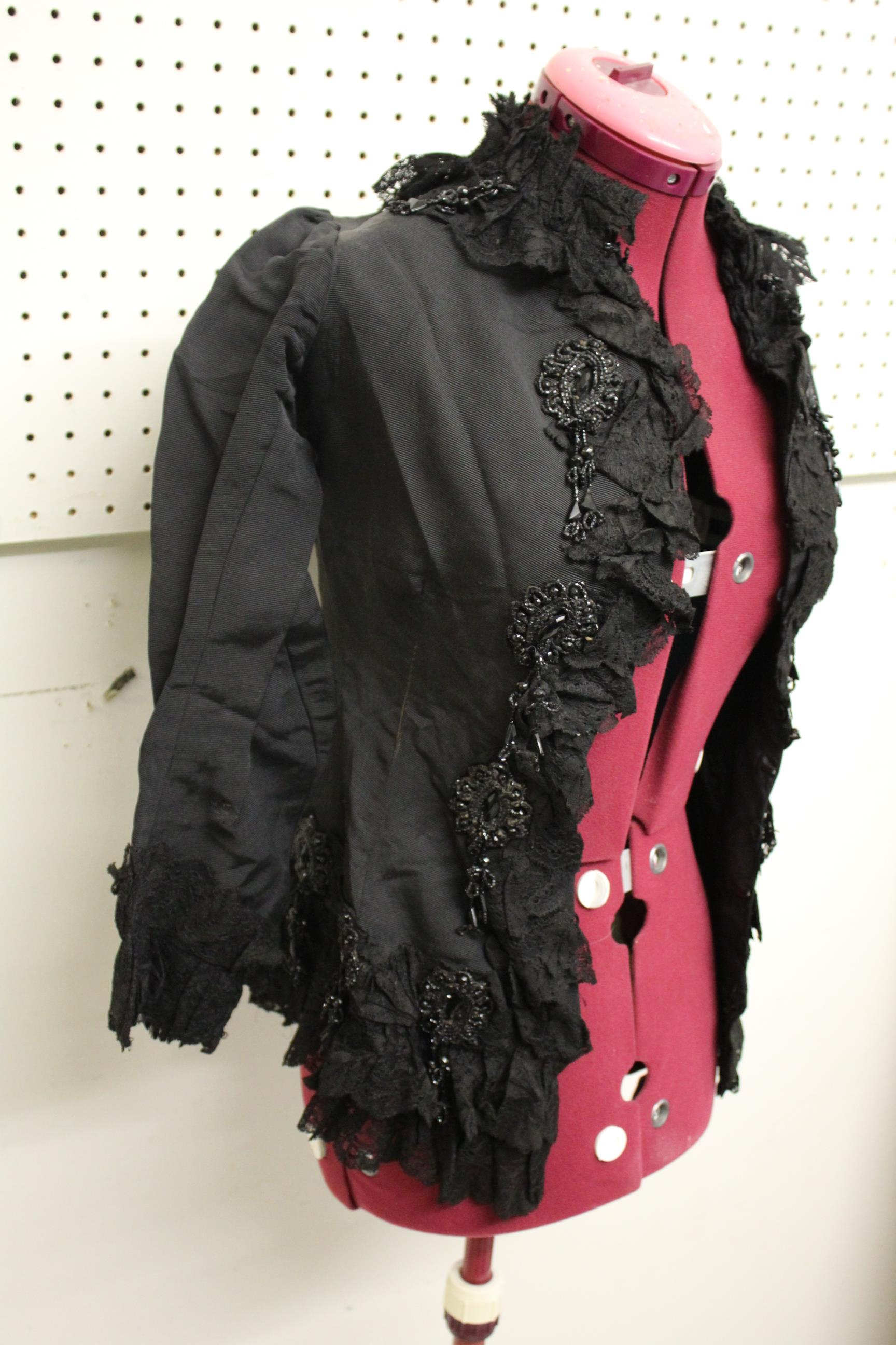 19THC JACKET a black grosgrain jacket embellished with lace and bead embroidered motifs, by Cole - Image 2 of 5