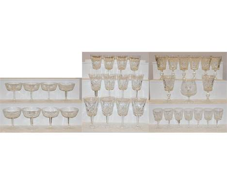 A part suite of Waterford crystal to include twelve red wine glasses, eight white wine glasses, eight champagne saucers, and