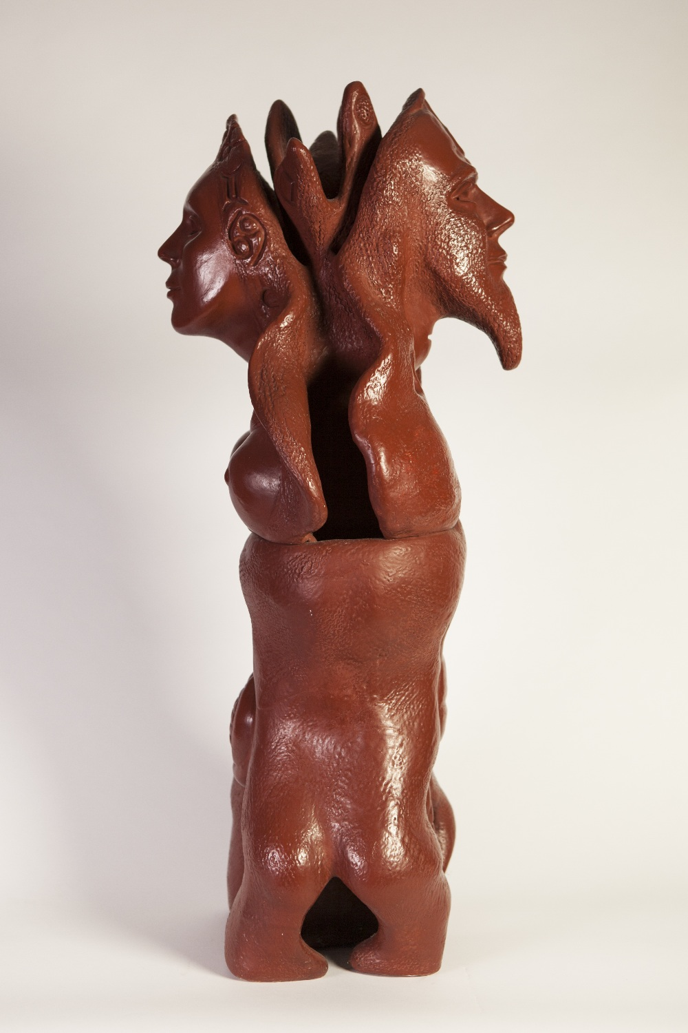 Lot 144 - GOLDA ROSE (1921 - 2016) DARK RED/BROWN GLAZED CLAY SCULPTURE Cosmic Male-Female' 1967, double sided