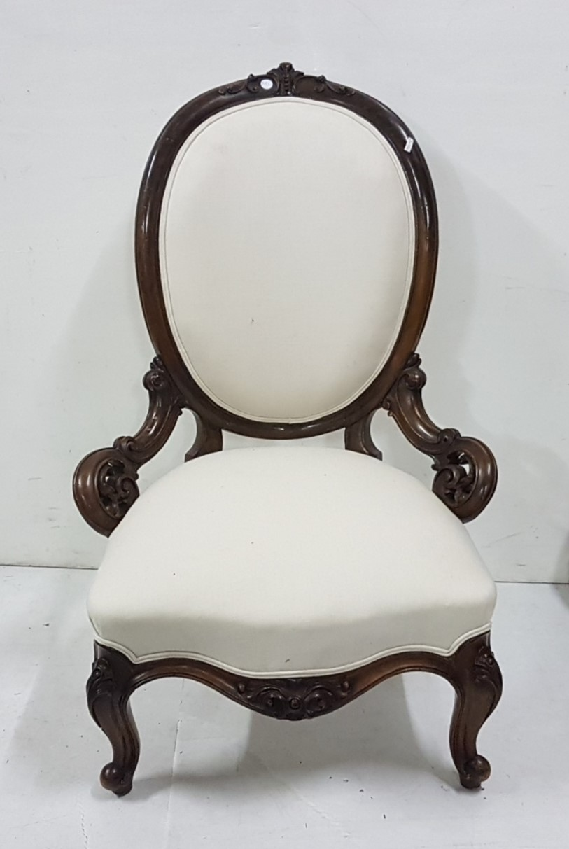 Lot 7 - Victorian mahogany framed Nursing Chair on carved cabriole legs, cream linen covered back and seat