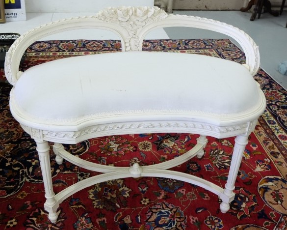 Lot 13 - Low Sized and curved window seat, painted cream with padded seat, on turned legs, 95cm w