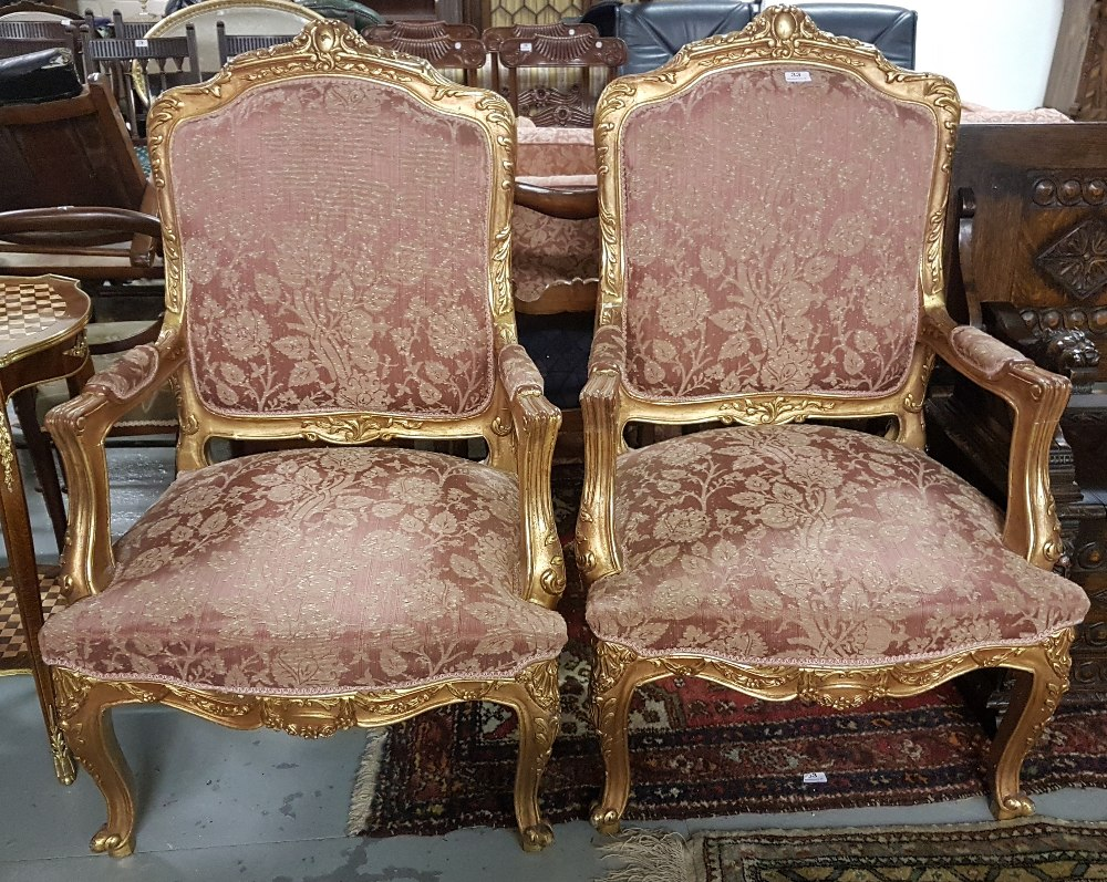 Lot 33 - Matching Pair of carved Gilt Wood Framed Armchairs, the backs and seats covered with red and gold