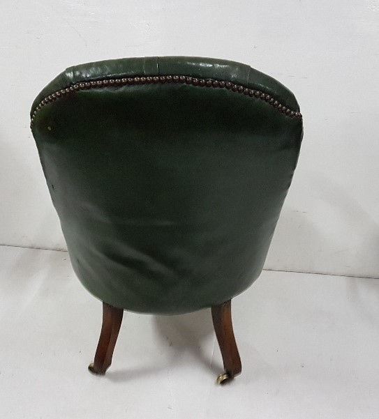 Lot 10 - William IV bleached mahogany open Armchair upholstered in green buttoned material, raised on