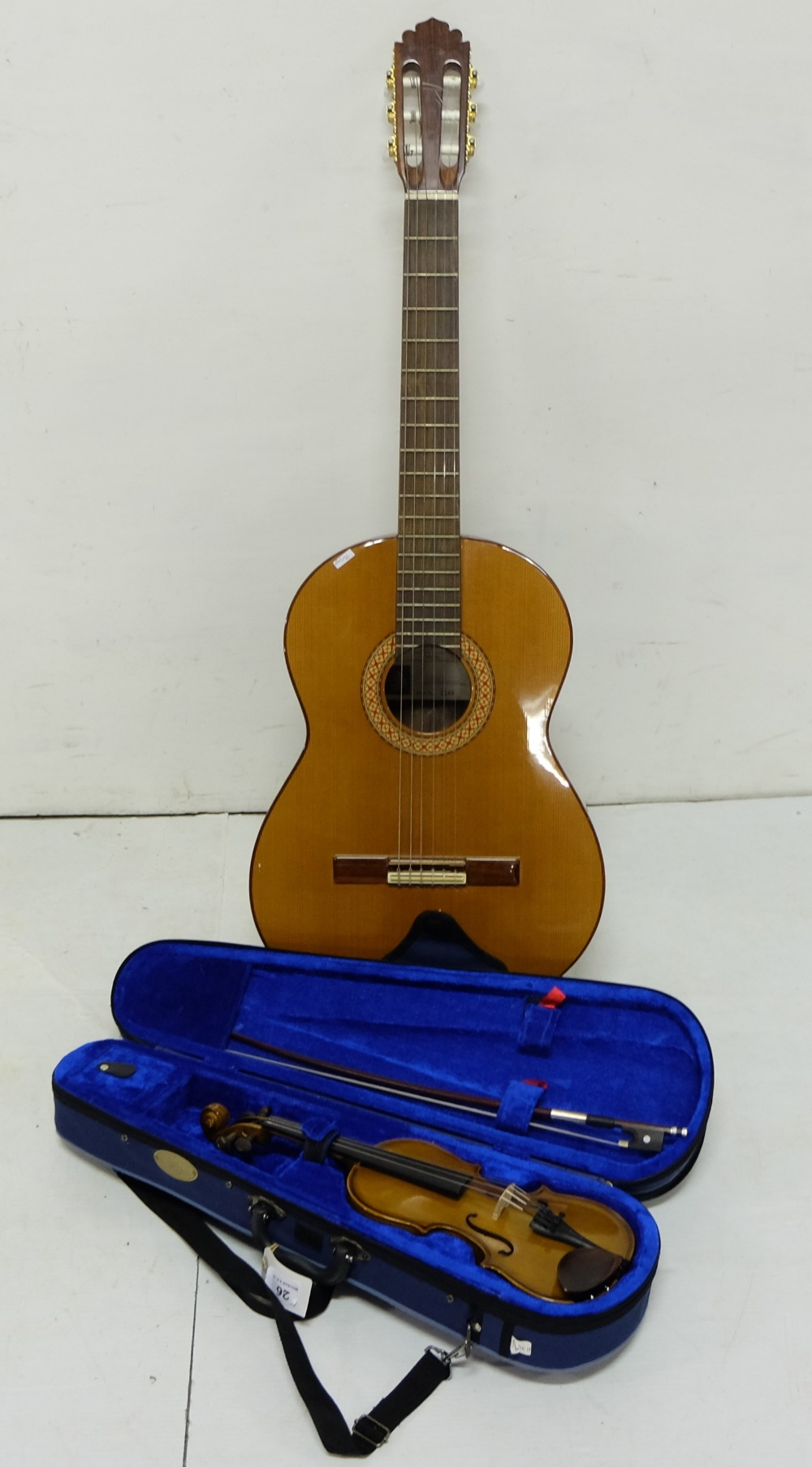 """Lot 26 - A Manuel Rodriguez six string acoustic guitar and Stentor 10.25"""" student violin with bow in fitted"""