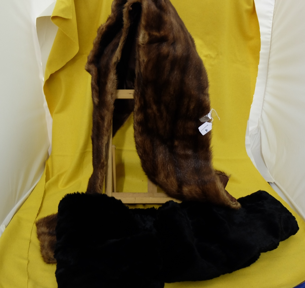 Lot 4 - 2 x Fur Stoles, one South African black fur Shawl and one medium brown Cape (2)