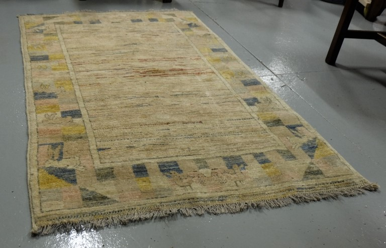 Lot 41 - Nursery Floor Rug, beige ground wool, featuring rabbit design borders, 94 x 155cm
