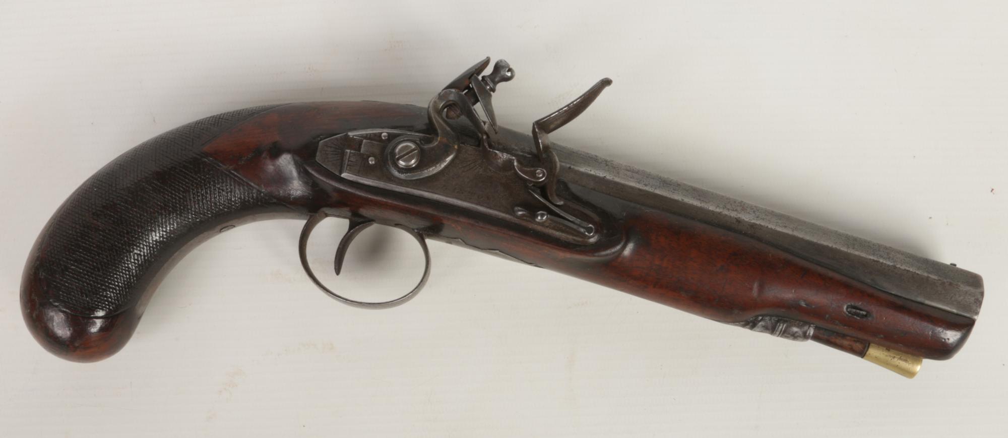 Lot 269 - A flintlock duelling pistol. With octagonal barrel, knurled walnut fullstock, ramrod and engraved