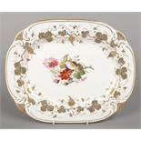 A Rockingham serving dish with C-scroll moulding. Decorated with a border of vines in gilt and