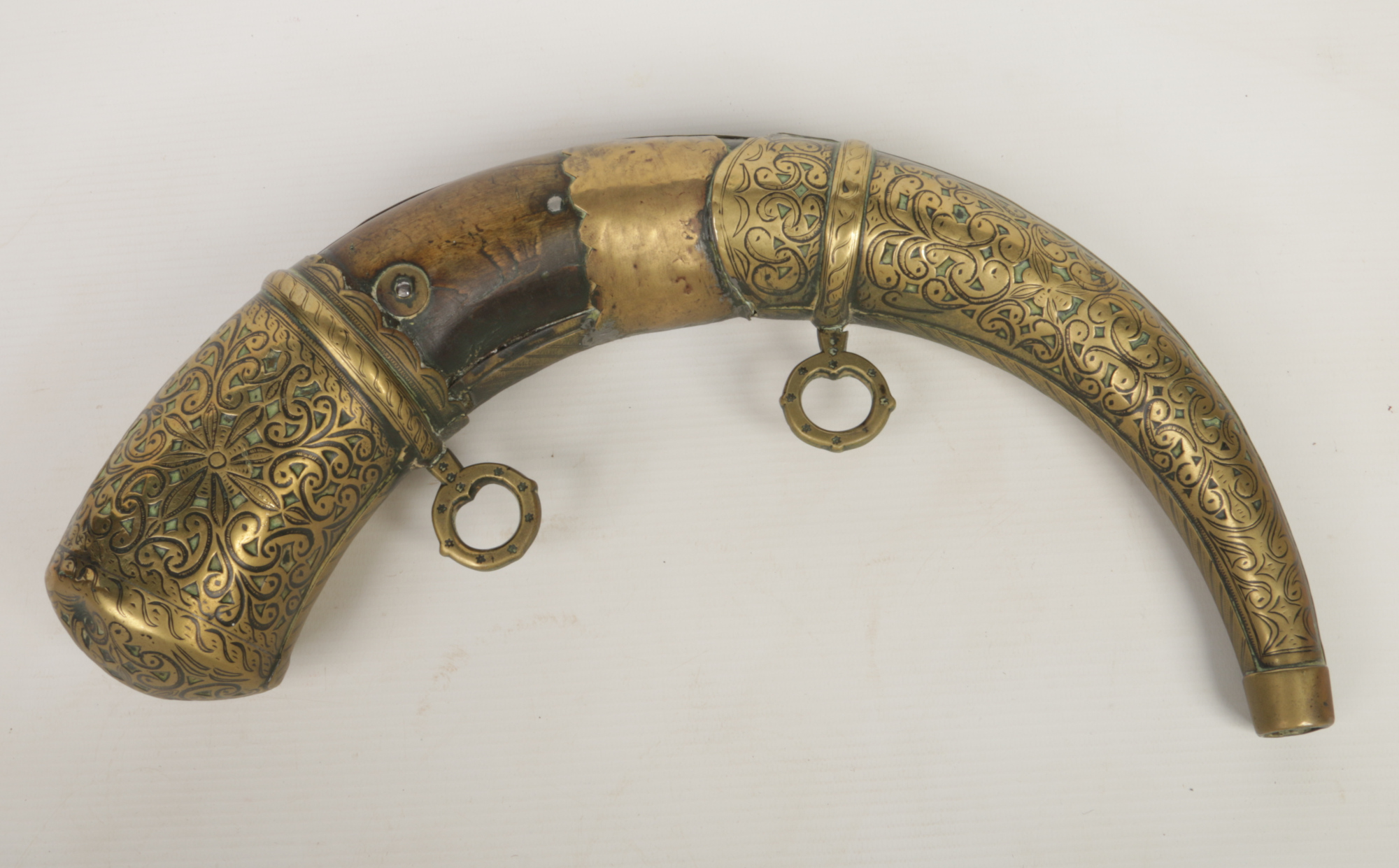 An 18th century brass mounted horn powder flask, 35cm.