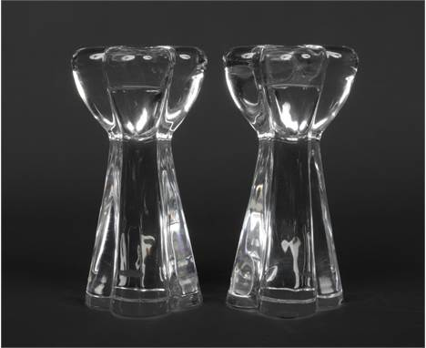 A pair of Baccarat crystal quatrefoil shaped candlesticks. Acid etched marks, 17.5cm.Condition report intended as a guide onl