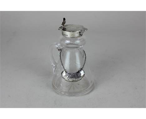 A George V silver and cut glass whisky noggin, maker John Grinsell & Sons, Birmingham, 1931, with matching silver whisky labe