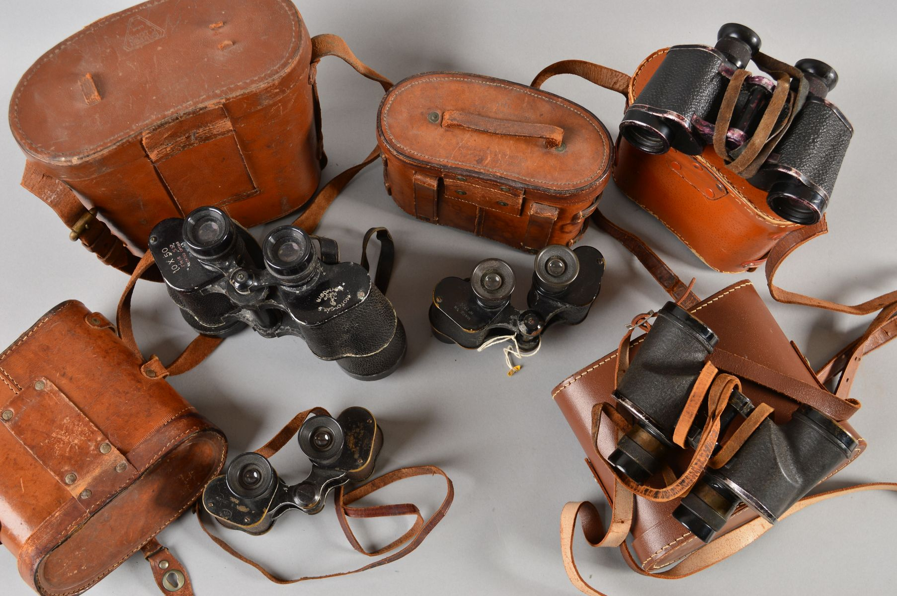 Lot 484 - FIVE PAIRS OF MILITARY BINOCULARS, as follows, all cased, but not all matching, Bausch & Lomb, US