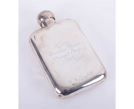 A silver hip flask with inscription dated 1917, height 14cm, approximately 4.80oz.