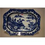 A Chinese blue and white meat plate, late 18th century, of shaped outline, 38.5cm wide.