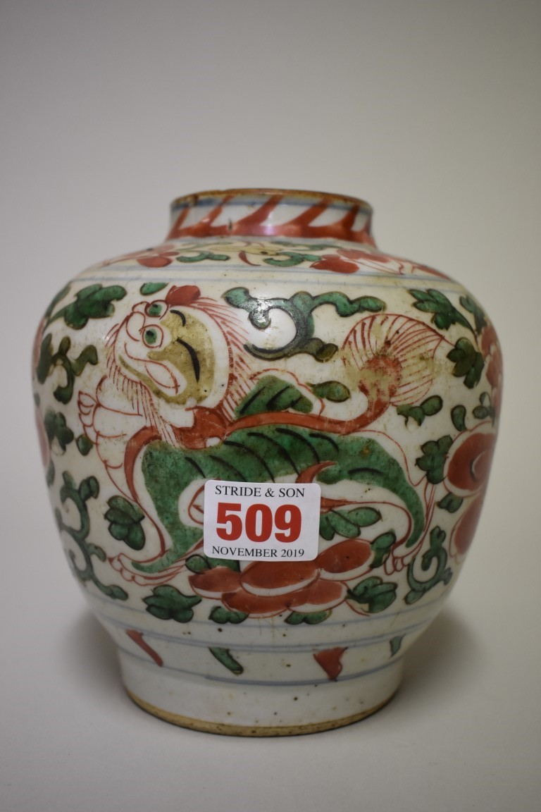 Lot 509 - A Chinese wucaijar, 17th century, painted with lion dogs and peonies, 17cm high.