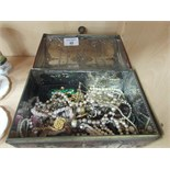 Lot 48 - Tin box containing costume jewellery