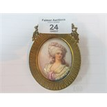 Lot 24 - Oval miniature painting of a woman