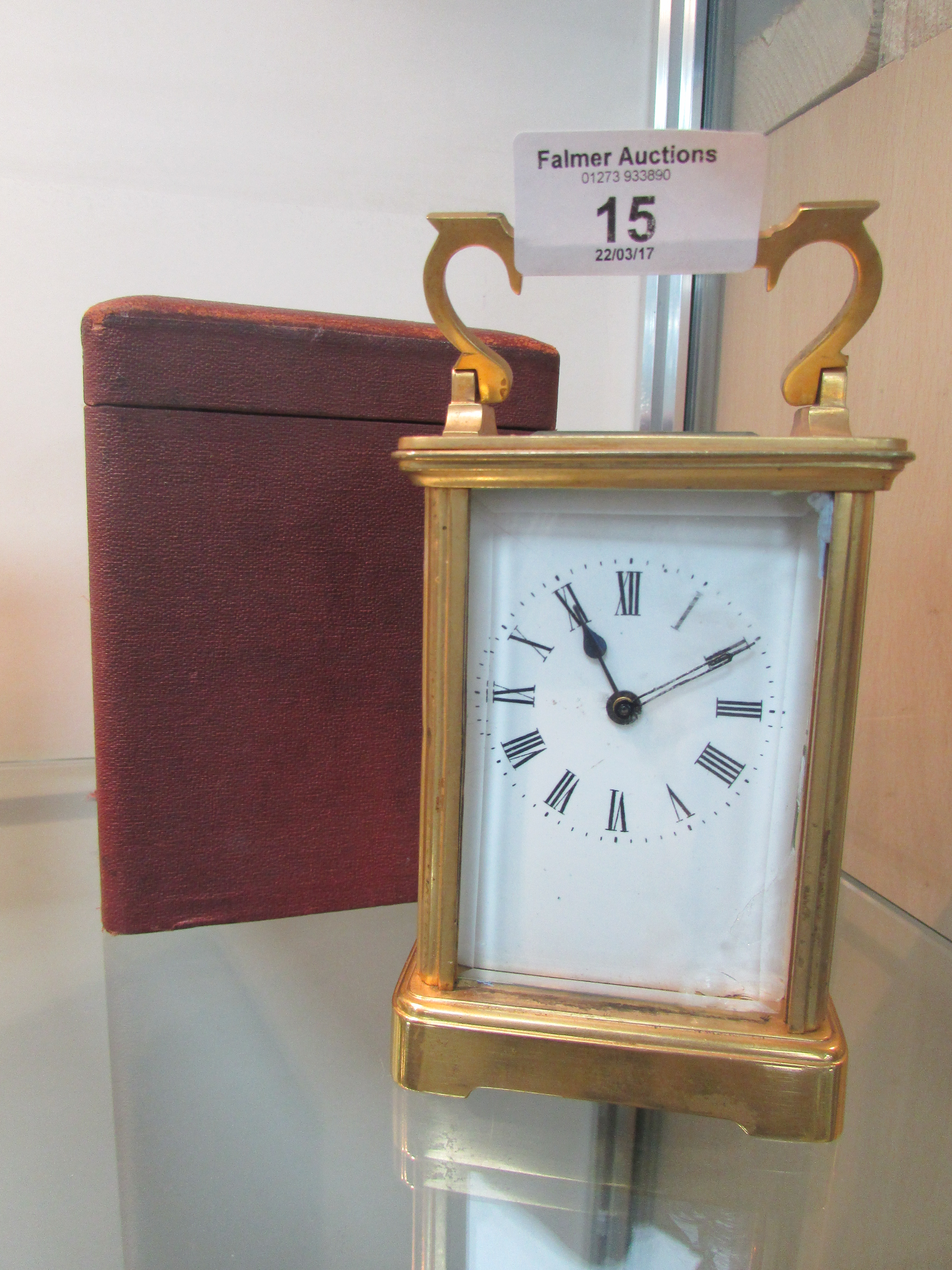 Lot 15 - Carriage clock and case (glass damaged)