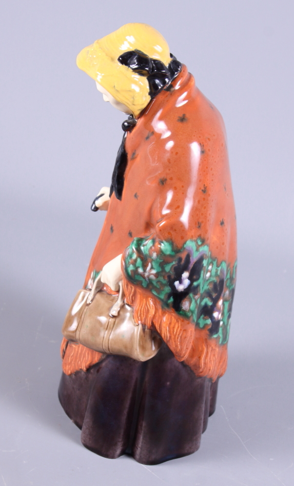 Lot 31 - A Gmunder Keramik porcelain figure of an old lady, painted in bright colours, with original label,