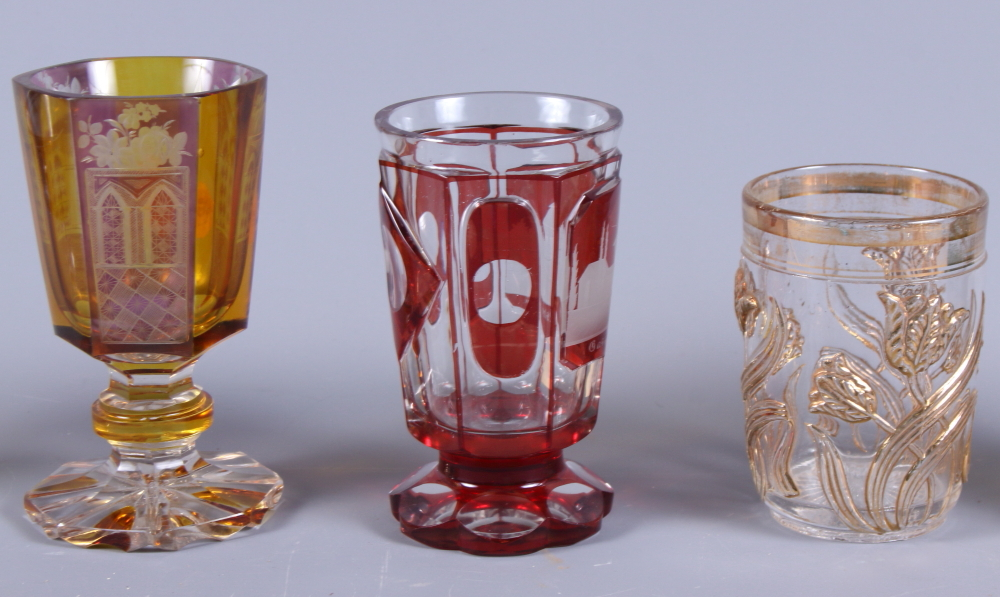 Lot 35 - Three early 20th century Bohemian glass goblets together with two other Bohemian glasses