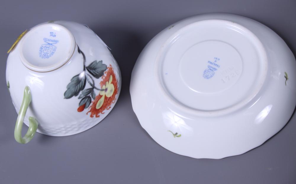 Lot 7 - Twelve pieces of Herend hand-painted porcelain, including plates, bowls, etc