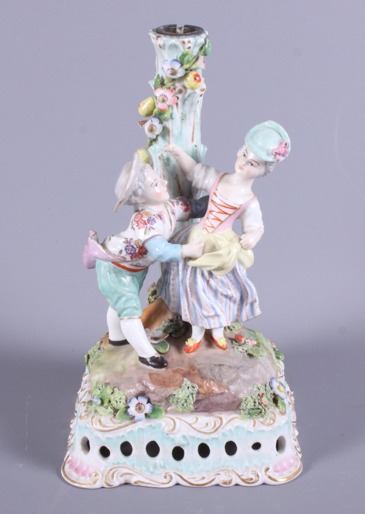 Lot 15 - A late 19th century Meissen porcelain figure candlestick, modelled in the form of two children