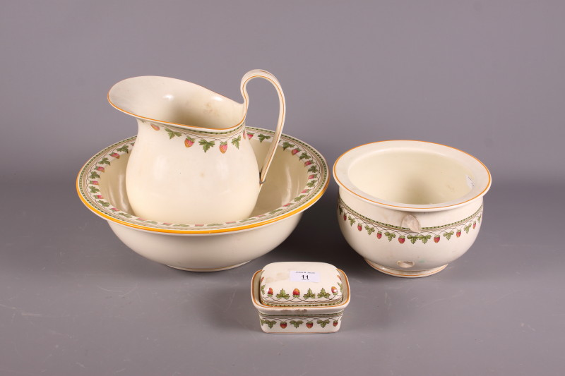 """Lot 11 - An early 20th century Wedgwood """"Strawberry Fruit"""" toilet set, comprising jug and bowl, soap dish and"""